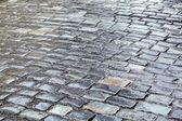 Wet cobblestone road closeup — Stock Photo
