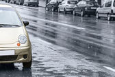Cars on wet road — Stock Photo