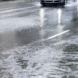 Driving in flooded street — Stock Photo
