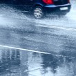 Car on wet road — Stock Photo