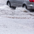 Постер, плакат: Driving on flooded street