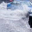 Flooded street and traffic — Stockfoto