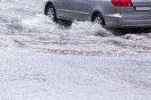 Driving on flooded street — Stock Photo
