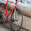 Stock Photo: Parked red bike