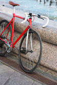Parked red bike — Stock Photo