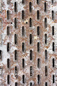 Perforated rusty metal — Stock Photo