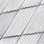 Gray asbestos roof — Stock Photo