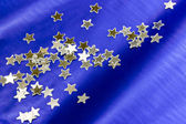 Blue background decorated with stars — Stock Photo