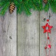 Christmas ornaments on wood — Stock Photo