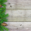 Christmas fir tree branch on rustic wooden board — Lizenzfreies Foto