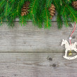 Fir branch with rocking horse — Stock Photo