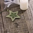 Christmas star ornaments with candle — Stock Photo