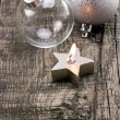 Candles and Christmas balls on wooden table — Stock Photo