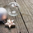 Burning Christmas candle with bauble — Stock Photo