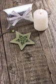 Christmas star ornaments with candle — Stockfoto