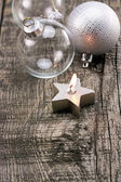 Candles and Christmas balls on wooden table — ストック写真