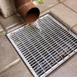 Home downspout and drain — Stock Photo