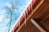 Icicles on the eaves — Stock Photo