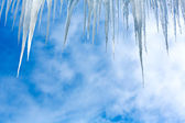 Icicles against a winter sky — Stock Photo
