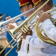 Stock Photo: Brass band musicians with trumpets