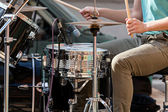 Musician playing drums on stage — Stock Photo