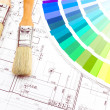 Brushes for paint over house plan on background — Stock Photo #44502421