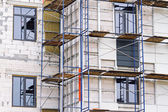 Building under construction with scaffolding — 图库照片