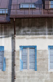 Facade with rain gutter — Stock Photo