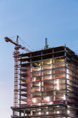 Building under construction on twilight time — Stock Photo