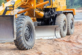 Closeup of road grader blade — Stock Photo