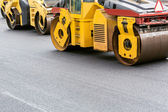 Yellow road rollers on repairing of the road — Stockfoto