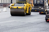 Asphalt paving works with road rollers — Stock Photo