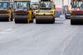Heavy steam rollers paving a road — Stockfoto