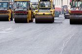 Heavy steam rollers paving a road — Foto de Stock