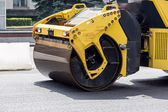 Road rollers paving a road — Stock Photo