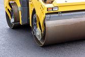 Steamroller at asphalt pavement works — Stockfoto