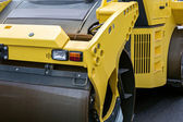 Yellow road roller closeup — Stockfoto
