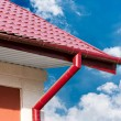 Gutter and red tiled roof — Stock Photo #51047657