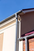 Corner of house with gutter — Stock Photo