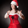 Santa girl shows OK — Stock Photo #15794069