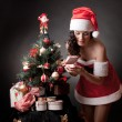 Stock fotografie: Santa girl open the gift.