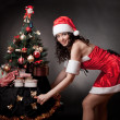 Santa girl open pull the Christmas tree. — Stock Photo #15799445