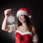 Santa girl holding snowflake — Stock Photo