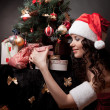 Santa girl open the gift. — Stock Photo