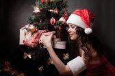 Santa girl open the gift. — Stock Photo