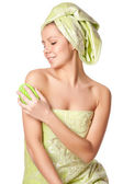 Woman in a towel does massage brush — Stock Photo