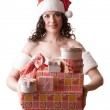 Santa girl is holding Christmas gifts. — Stock Photo #16350413