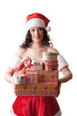 Santa girl is holding Christmas gifts. — Stock Photo