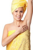 Beautiful young girl in a towel after depilation — Stock Photo