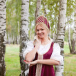 Woman in Russian traditional costume - Stok fotoğraf